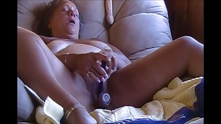 Horny fat granny masturbating with toys exposed to cam