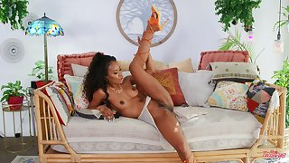 Ebony woman in solo scenes presently fingering like a star