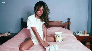 Instead of eating popcorn sexy babe Camila enjoys teasing the brush wet pussy