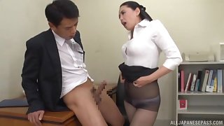 Fabulous Asian coworker gets down on her knees to give a blowjob